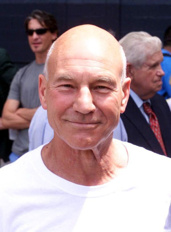 A color photograph shows actor Patrick Stewart was among more than 20,000 soccer fans watching the All-Star game. Stewart sought an introduction to Staff Sgt. Alvy Powell (not shown) after Powell, a well-known opera singer, performed the National Anthem.[1]